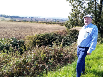 Cllr Paul Jacobs at the site of the proposed new housing development